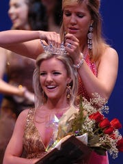 Christa McCann smiles as she is crowned Miss Acadiana for 2009 by last year's Miss Lafayette Michelle Mayer Sunday afternoon at UL's Angelle Hall.