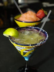 In this file photo, Lime and frozen strawberry margaritas
