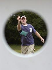 Doug Byers of Mason demonstrates corn hole.