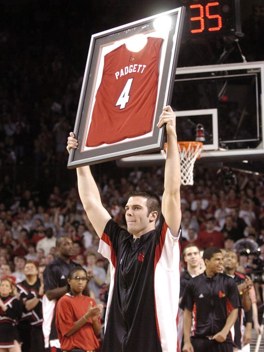 TITLE: DAVID PADGETT HOLDS HIS FRAMED JERSEY
