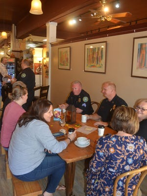 Gallatin Police Chief Don Pandy and members of the department had coffee with residents of Gallatin Wednesday morning at Govan's Coffee Café for Coffee with a Cop.