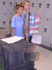 Fourth graders Mason Garrison and Reese Dowell present
