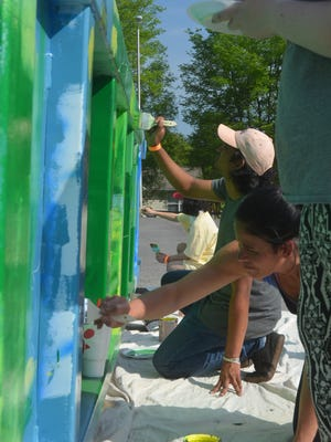 Volunteer State Community College art students helped Gallatin High School art teacher Catherine Stewart paint Monet's Water Lilies on a city-owned recycling bin.