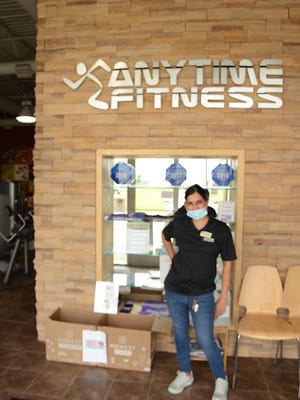 Anytime Fitness co-owner Vrunda Desai encourages neighbors to drop off non-perishable food items before July 7. The items will be given to the Melissa Rotary Club.