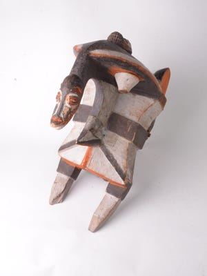 A double crest mask made of wood and pigment from the mid-20th-century Igbo culture.