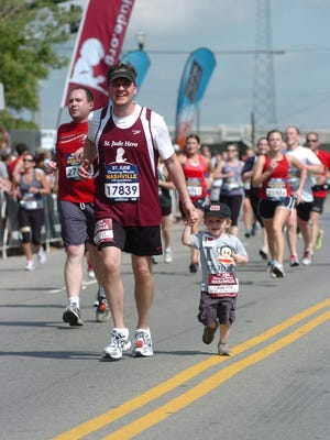 """In 2012, during the final leg of a particularly grueling Country Music half-marathon, Ian Miller joined his dad, Jason, in crossing the finish line. """"I can suffer through the uncomfortable … to be there for him. To support him and support St. Jude,"""" Jason Miller says."""