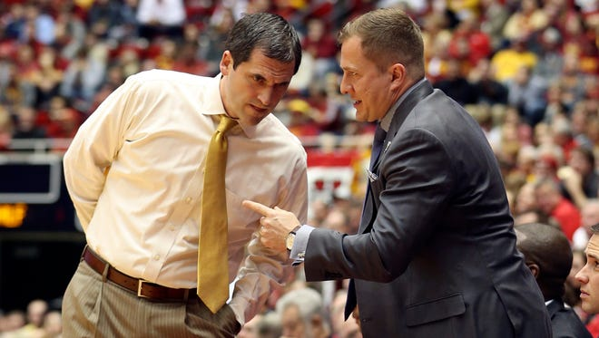 Iowa State Cyclones head coach Steve Prohm and assistant coach T.J. Otzelberger visit during a timeout last year at Hilton Coliseum in Ames, Iowa.