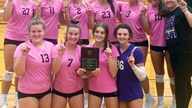The Camdenton volleyball team celebrates its Mount Vernon Tournament championship on Saturday, October 3.