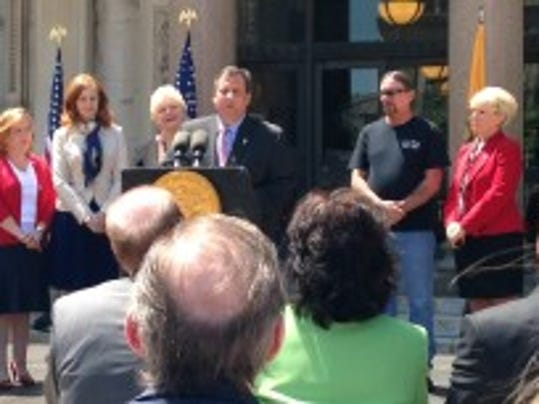 Gov. Chris Christie speaks at the ceremonial bill signing for the Jessica Lunsford Act, June 2, 2014 on the Statehouse steps. Mark Lunsford stands to Christie's left. (Michael Symons/Asbury Park Press)