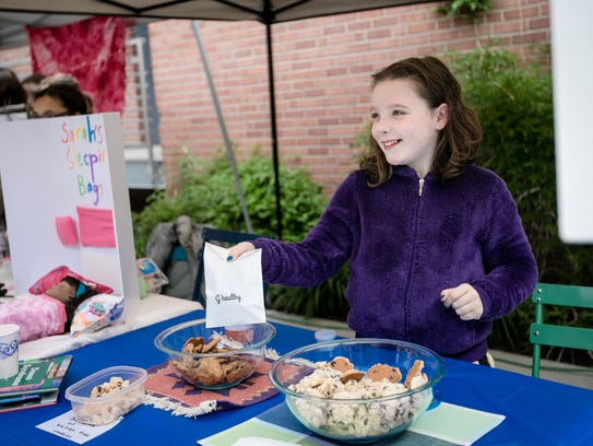 Gabriella Mckain, of Ithaca, sells foods and snacks