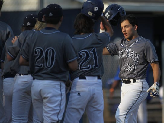 Maclay's Matt Caballero is mobbed at home plate by