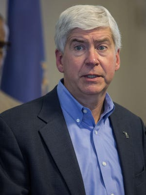 Gov. Rick Snyder listens and answers to questions from the press during the Flint water criss press conference on Monday, Jan. 11, 2016 at City Hall in Flint. Tim Galloway/Special for DFP