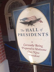 A sign in front of the Hall of Presidents at Walt Disney World's Magic Kingdom alerts park guests to an ongoing update of the attraction.