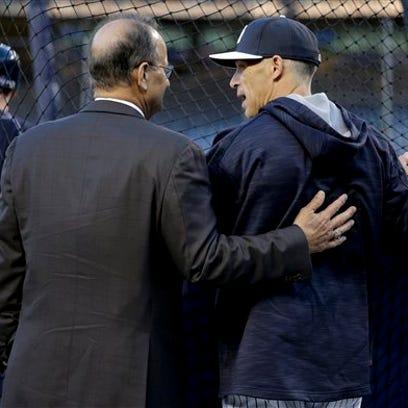 Former New York Yankees manager Joe Torre, left, talks