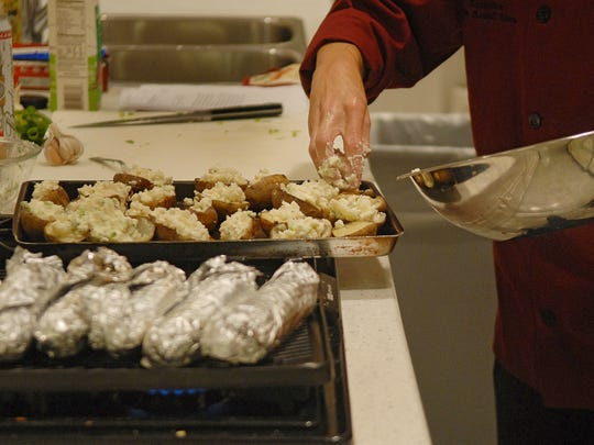 Chef Jimmy Klein of Spencerport prepares the Gorgonzola Twice-Baked Potatoes with bacon.