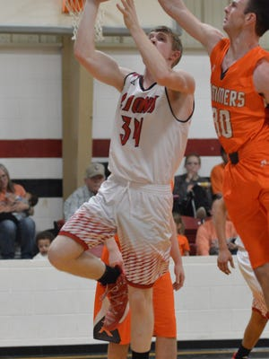 Rotan's Jaydon Fronterhouse blocks a second-quarter shot from Roby's Landon Estes during Tuesday's game in Roby.