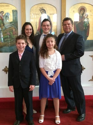 Ithaca Alderman Steve Smith, back row center, stands with his wife, Genevieve, and Nick Lambrou, president of St. Catherine Greek Orthodox Church, during a program Sunday to mark the 195th anniversary of Greek Independence Day. In the front row are Alex Lambrou and Amanda Hopko, who recited traditional Greek poems for the program.