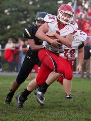 Buffalo Gap's Jay Johnson attempts to tackle Riverheads'
