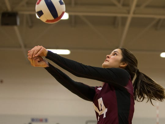 Flour Bluff's Cali Nims bumps the ball during their