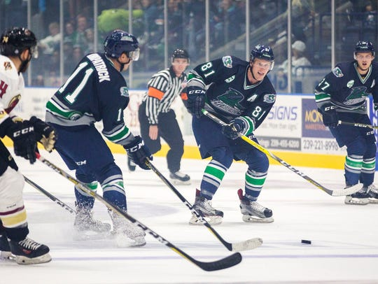 Everblades forward Stephen MacAulay, second from right,
