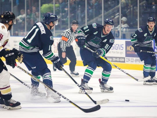 Everblades forward Stephen MacAulay, second from right, maneuvers the puck down the rink during the first period at the Germain Arena, where the Florida Everblades took on the Atlanta Gladiators on Friday, Oct. 13, 2017.