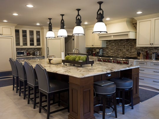 The luxury kitchen includes an oversized granite island