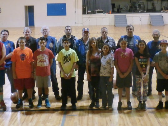 Knights of Columbus Council #6597 volunteers and free throw competitors are seen here after the local competition Jan. 23 in Ruidoso.