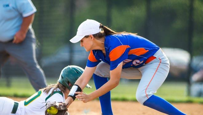 Mardela catcher Mackensie Disbennett (10) slides back into first under the tag of Boonsboro first baseman Brooke Singleton (10) in the 1A MPSSAA semifinals at the Bachman Athletic Complex in Glen Bunie on Wednesday, May 25.