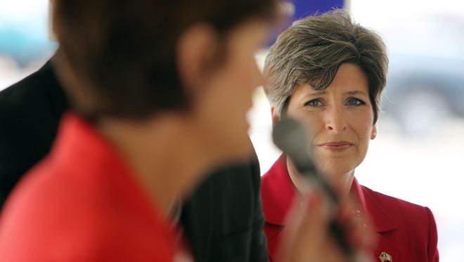 U.S. Senate candidate Joni Ernst listens as Iowa Lt. Gov.  Kim Reynolds speaks, during a stop on a 14-city General Election Kickoff Tour with Republican candidates, Wednesday, June 4, 2014, at the Des Moines County Republican headquarters in Burlington, Iowa. (AP Photo/The Hawk Eye, John Lovretta)