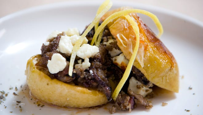 Stuffed Apples with bacon, onion, crimini mushrooms, feta or cotija cheese, maple syrup made by Chef J Whiting.