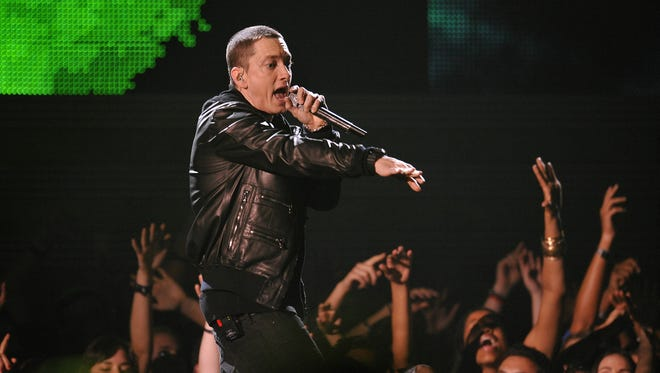 "Eminem performs at the 2011 Grammy Awards. ""The Marshall Mathers LP2"" is officially released Tuesday, Nov. 5, 2013."