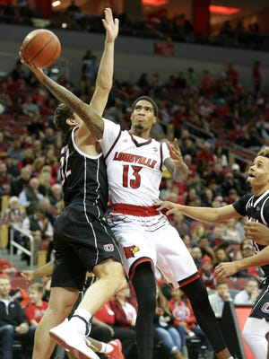 Ray Spalding lays in 2 of his 19 points against Omaha. Spalding also hauled down 11 rebounds. Nov. 17, 2017.