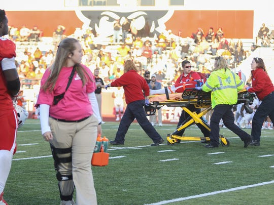 Austin Peay defensive back Malik Boynton (2) is taken off the field on a stretcher after a tackle against Mercer during the 2016 season.