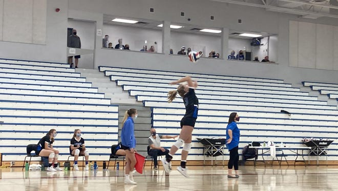 Fort LeBoeuf's Katie Proctor serves against Villa Maria in a girls volleyball match on Tuesday, Sept. 15, 2020. The stands were empty because of the state 25-person limit for indoor gatherings. A small group of fans was allowed in the plexiglass-enclosed press box.