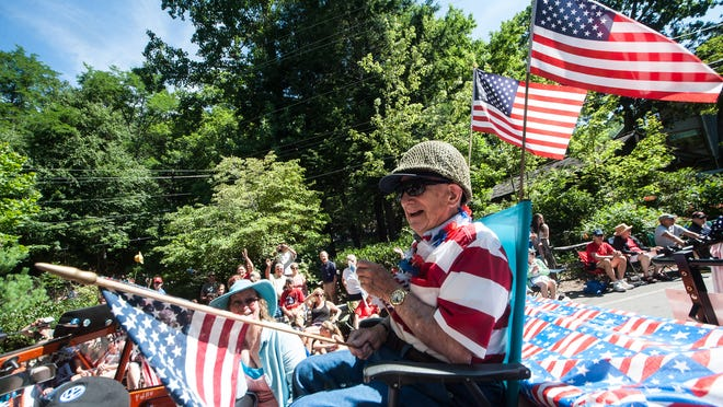 Andy Andrews greets the crowd at the Montreat Fourth of July parade. Seventy years ago, Andrews spent the holiday in France, less than a month after landing on Omaha Beach during the D-Day invasion that led to the end of World War II.