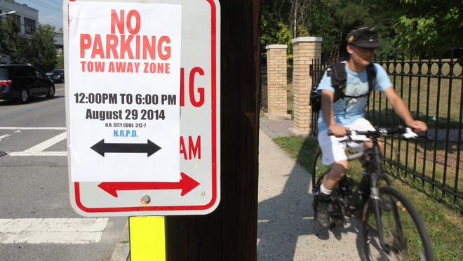 """""""No parking"""" signs are visible along Route 1/Main Street in New Rochelle Wednesday. They were placed in preparation of President Obama's upcoming visit to the area."""