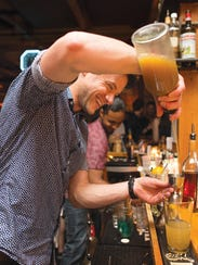 Chuck Cerankosky mixes a drink at a Rochester Cocktail