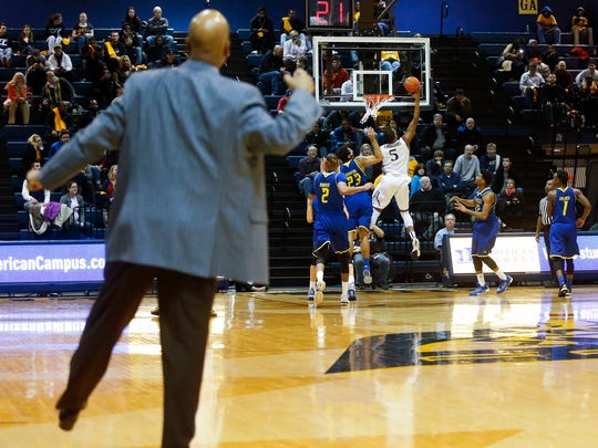 Delaware head coach Monte Ross strays on the court but his body language can't help Delaware to a defensive stop as they try to rally late in the second half of the Blue Hens' 74-64 loss at the Daskalakis Athletic Center in Philadelphia, Pa.