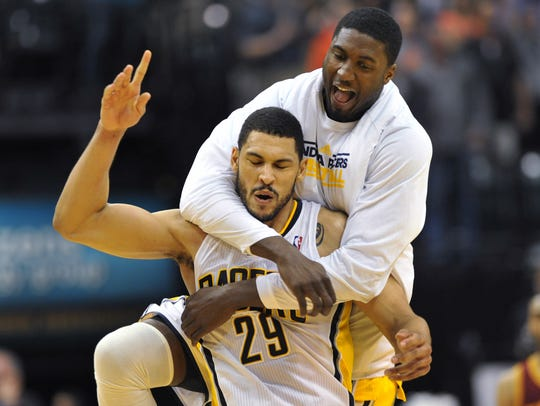 Indiana's Roy Hibbert jumps on the back of teammate