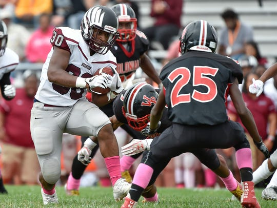 Hodgson's Darius Hale (30) rushed 18 times for 86 yards and three touchdowns in Saturday's 24-8 win at William Penn.