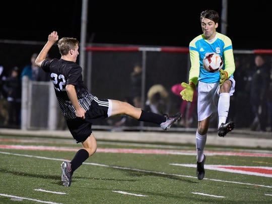 Appoquinimink's Matthew Meadows (22) with a shot on goal in the DIAA Division I State Soccer Championship at Smyrna High School.
