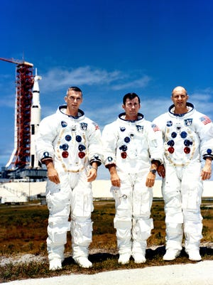 The crew of Apollo 10, from the left, Eugene Cernan, John Young and Thomas Stafford, are photographed while at the Kennedy Space Center. The three crewmen had just completed a Countdown Demonstration Test exercise on May 13, 1969.