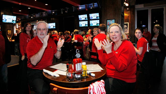 University of Louisville fans cheer for the women basketball team as they wait to see where they'll be playing in the NCAA tournament at the Sports and Social Club  in Louisville, Kentucky.        March 14, 2016.