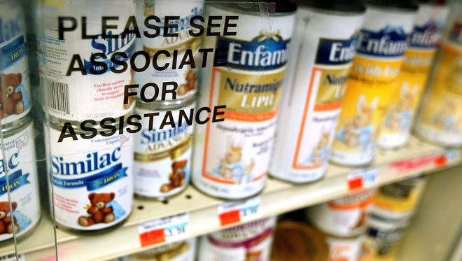 Cans of baby formula are seen locked behind glass at a Chicago pharmacy in this 2005 photo. Baby formula thefts have been common across the country and several recently occurred in the Coachella Valley.