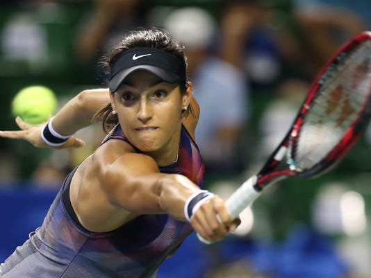 Caroline Garcia of France returns a shot to Garbine Muguruza of Spain during their quarter-final match of the Pan Pacific Open tennis tournament in Tokyo, Friday, Sept. 22, 2017. (AP Photo/Koji Sasahara)