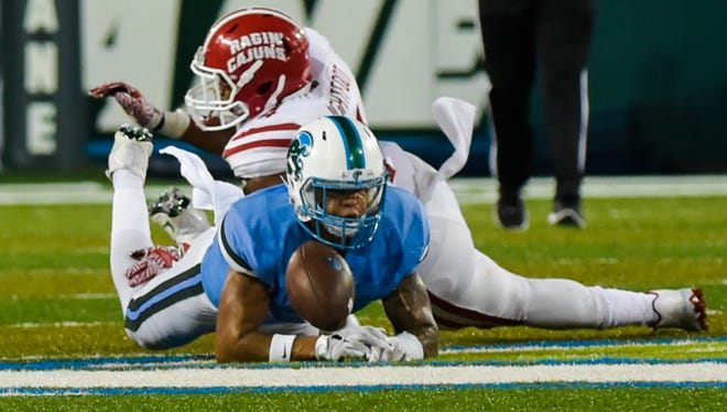 Linebacker Tre'maine Lightfoot (top) breaks up a pass during UL's quadruple-overtime loss at Tulane earlier this season.