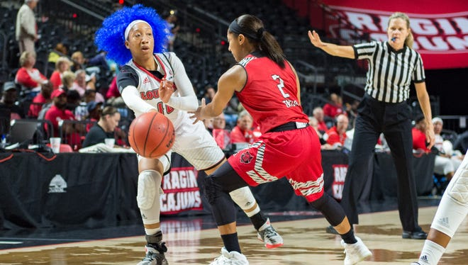 UL's Troi Swain passes the ball down low during the Cajuns' 60-53 win over Arkansas State on Thursday at the Cajundome.