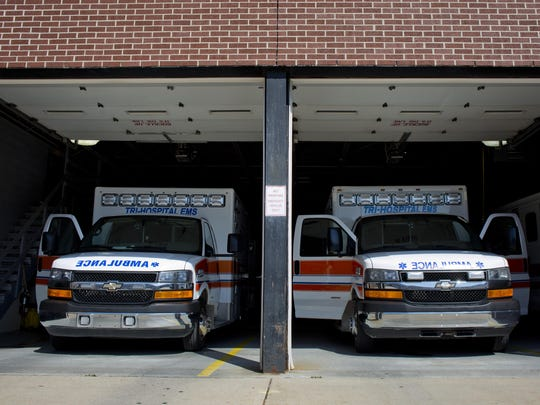 Ambulances are parked in a bay Thursday at Tri-Hospital EMS in downtown Port Huron.