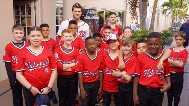 Baseball superstar Bryce Harper shot a commercial Feb. 26 with this real-life youth baseball team from Port St. John, Florida.