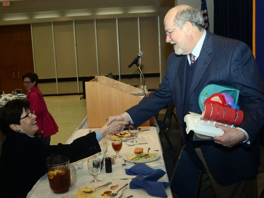 ANI Rotary Club Dr. Freedman Nerine Day (left) speaks with cardiologist Dr. Robert Freedman who was the guest speaker at the Rotary Club of Alexandria Tuesday, Feb. 17, 2015.-Melinda Martinez/mmartinez@thetowntalk.com The Town Talk Gannett